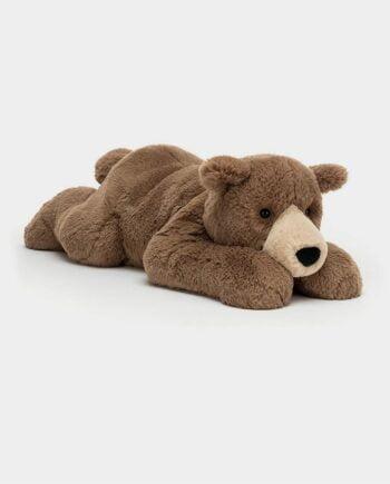 peluche ours allongé